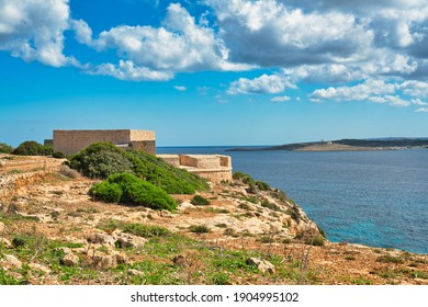 View of Saint Mary's Battery, an artillery battery on the island of Comino. The historic military building is located on the coastline with a great view of the mediterranean landscape of Malta.