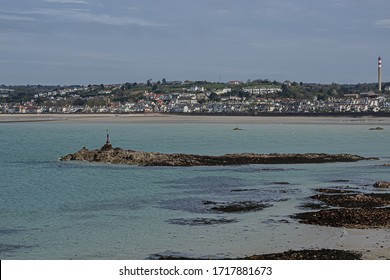 View of Saint-Aubin Bay and Jersey island with Saint Helier city on the background from Elizabeth Castle (1594). Saint Helier, Jersey, United Kingdom.