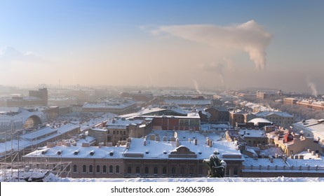 View of Saint-Petersburg from the colonnade of St. Isaacs Cathedral frosty winter morning and smoke energy power stations