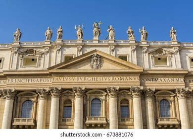 A view of Saints statues on top of St. Peter's Basilica in the Vatican city, Rome, Italy