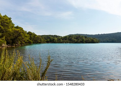 View of the saltwater blue colored lakes of malo and veliko jezero at the National Park on the island Mljet, Croatia. Mediterranean coast with greenery creating a serene calm scene, UNESCO protected