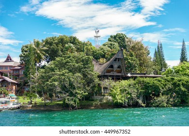 View of Samosir island from water, Toba lake, North Sumatra, Indonesia
