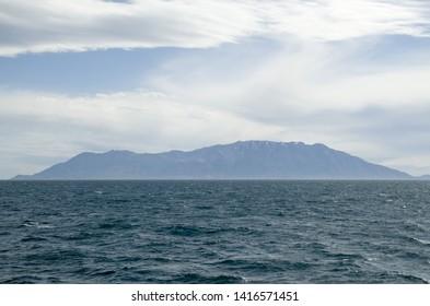 View of  Samothraki island  and mountain Saos in Greece from the sea in cloudy day