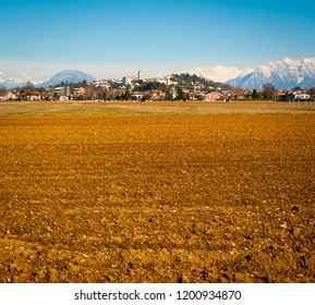 View of San Daniele del Friuli from the surrounding fields on a sunny winter day, Friuli Venezia-Giulia, Italy