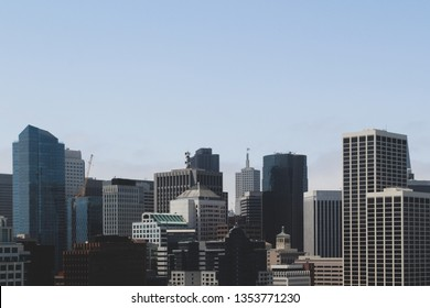View of San Francisco city skyline with skyscrappers on blue sky background.