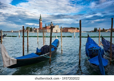 View of San Giorgio Maggiore church seen from the main island in Venice, Italy, with gondolas and amazing blue sky with clouds.