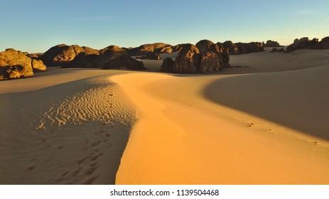 View of sand dune at sunset in national park Tassili n'Ajjer, Sahara desert