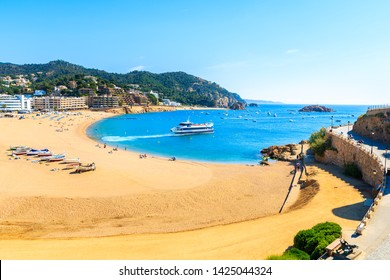View of sandy beach and bay in Tossa de Mar town from castle, Costa Brava, Spain