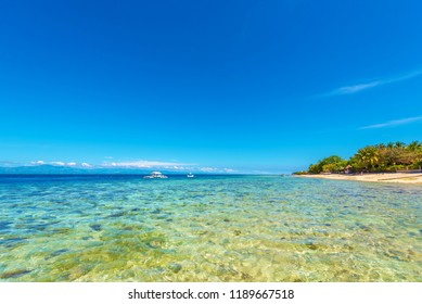 View of the sandy beach in Moalboal, Cebu, Philippines. Copy space for text