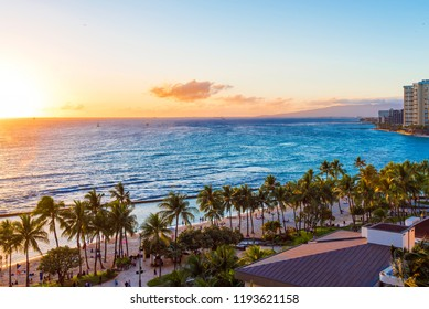 View of the sandy beach at sunset, Honolulu, Hawaii. Copy space for text