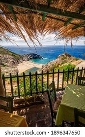 View from the sandy beach with transparent turquoise waters and a stream, in Kato Raches village, Ikaria island, Greece