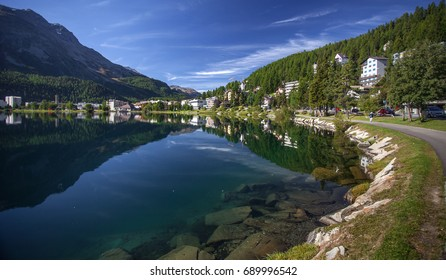View of Sankt Moritz (lake and town) in a sunny summer day