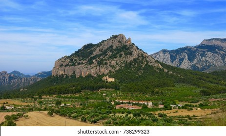 View of Santa Barbara Mountain and Saint Salvador d'Horta monastery, also called the Convent of Angels, from village of Horta de Sant Joan in Catalonia, Spain.