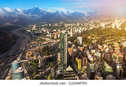 View of Santiago de Chile with Los Andes mountain range in the back at sunset time
