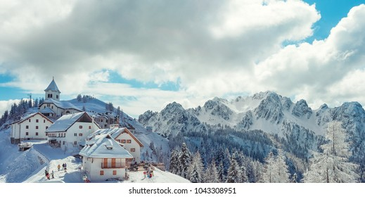 View of Santuario della Madonna del Lussari little village covered with snow in Tarvisio, Friuli Venezia Giulia, Northern Italy.