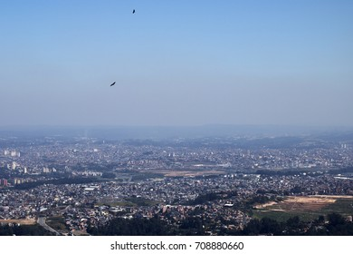 View of Sao Paulo from Pico do Jaraguá (Jaragua Peak) which is the highest mountain in the city. Its located at the Serra da Cantareira (Mountain Range), Brazil. Pollution in the air.