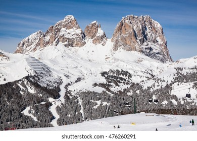 View of the Sassolungo (Langkofel) Group of the Italian Dolomites in Winter from the Belvedere Ski Area in Canazei.