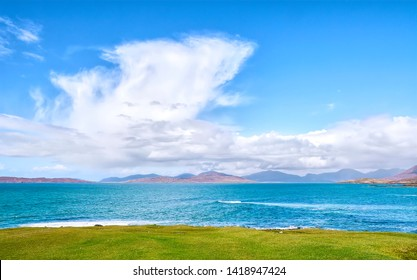 View from Scarasta over the isle of Taransay to the mountains if North Harris UK