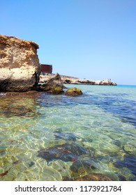 view of the sea from the bay. a break in the sea a large limestone stone, the Mediterranean Sea, clear water, the bottom