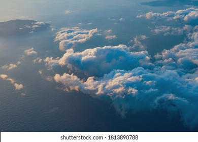 View of the sea and clouds seen from a passenger plane