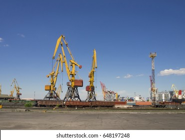 View of the sea complex for transshipment of metal with a cranes in the foreground