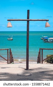 View to the sea with a cross lamp at Praia do Forte, Brazil