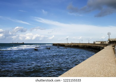 View of the sea of livorno from the singular terrace Mascagni in Livorno, Italy. Mascagni terrace is a paved terrace checkered along the seafront, close to the harbor of Livorno.Blue sky and clouds on