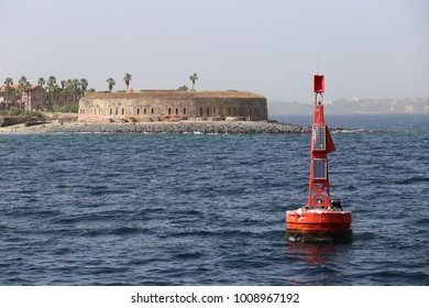 View from the sea of the old circular fort of Goree island in senegal, called fort d'estrées. Ancient stone fortress building transformed in museum. Seascape picture taken on 21st november 2015.