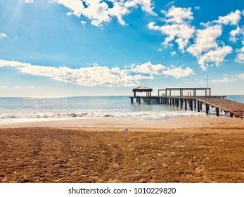 View of the sea and pier at sunset, wide beach, blue sky and wonderful clouds in Belek Antalya