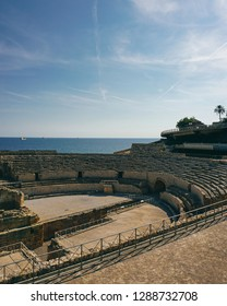 View of the sea and the Roman amphitheater in the city of Tarragona, Tarraco during the times of the Roman Empire. Spain