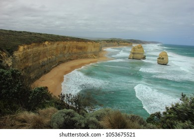 The view of sea side cliff Gibson Steps with two enormous sea stacks called Gog and Magog at along the Great Ocean Road in Victoria, Australia.