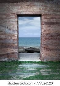 View of sea through a rock window