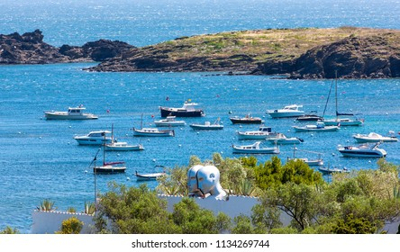 View of seaside Cadaques village and the roof of the house of Salvador Dali. In style of Dali artist's. Costa Brava, Catalonia