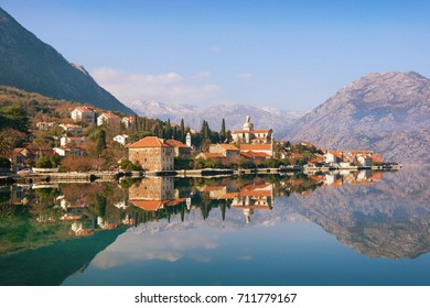 View of seaside Prcanj town on a sunny winter day. Bay of Kotor (Adriatic Sea), Montenegro
