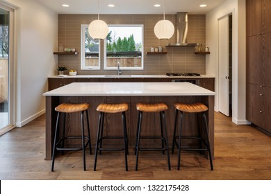A view of the seating in the kitchen with the lights on