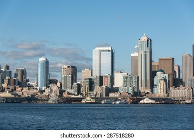 A view of Seattle downtown, Business district, Space Needle and blue ocean under a clear blue sky from Alki beach