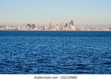 View of Seattle waterfront from the sea at sunset