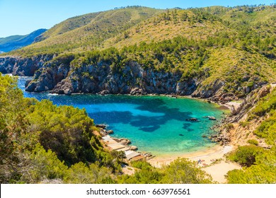 View of secluded Cala d'en Serra beach and coastal cliff rocks, Ibiza island, Spain