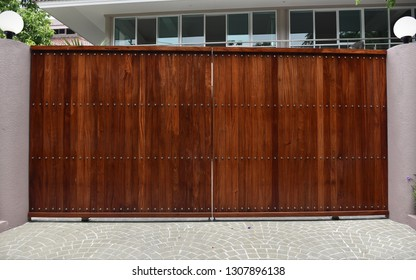 View of a Secure Wooden Gateway of a Luxury Suburban Housing Complex