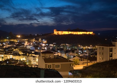 View of Selcuk with Ayasuluk fortress during sunset in the evening, Turkey