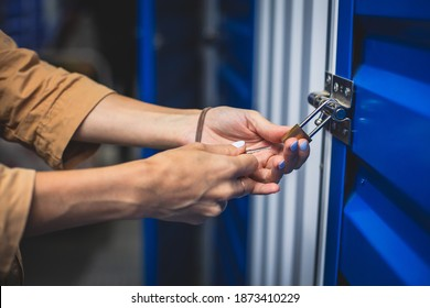 View of self storage warehouse, process of keeping and storing the goods and items in storage units, self-storage building, lock and key concept