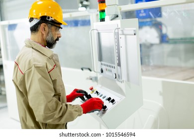 View at senior man working in factory