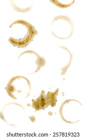 View of several stains of coffee over a white background.