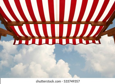 View from shade below red white striped awning