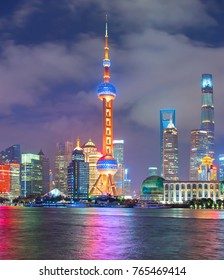View of Shanghai Downtown at night with reflection in the river