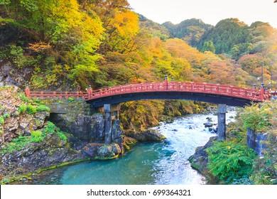 View of Shinkyo bridge (red wood bridge) in autumn season, one of famous travel destination of Nikko, Japan. - Shutterstock ID 699364321