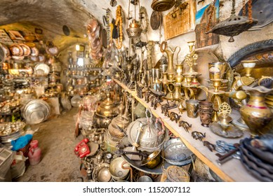 View of a shop with lots of copper coffee pots on foreground for sale in Mardin,Turkey.