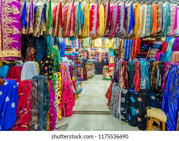 View of a shop where different traditional local clothes were sold in  Huseyniye Bazaar in Sanliurfa,Turkey.