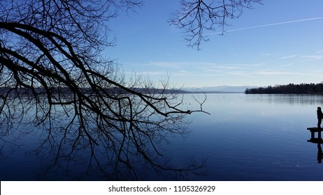 A view from the shore of Ammersee in Utting lake in Bavaria Germany during a mild December day with Alps in far background