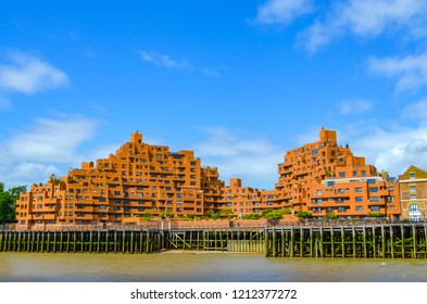 View to the shore development of the Thames at ebb tide in London, UK